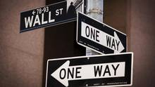 A Wall Street sign is seen above two 'One Way' signs in New York in this August 24, 2015, file photo. (Lucas Jackson/Reuters)