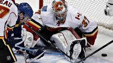 Vancouver Canucks Alex Burrows (L) scores on Calgary Flames goalie Leland Irving during the second period of their NHL game in Vancouver, British Columbia February 9, 2013. (ANDY CLARK/REUTERS)