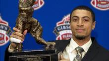 Hamilton Tiger-Cats wide receiver Chris Williams holds his award for the CFL Outstanding Rookie Thursday November 24, 2011 in Vancouver. The B.C. Lions will face the Winnipeg Blue Bombers in the 99th Grey Cup CFL football final Sunday. THE CANADIAN PRESS/Jonathan Hayward (Jonathan Hayward/CP)