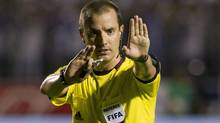 Mark Geiger signals a call at a World Cup qualifier in Brazil in this file photo. (Moises Castillo/The Associated Press)