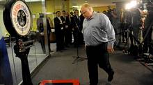 Mayor Rob Ford heads for the scale during his weekly weigh-in at City Hall on April 16, 2012. (Fred Lum/The Globe and Mail/Fred Lum/The Globe and Mail)