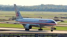 This October 4, 2008 photo shows an American Airlines aircraft taxiing to the gate at Dulles International Airport in Dulles, Virginia. American Airlines on July 20, 2011 announced a massive multi-billion-dollar order for 200 Boeing 737 and 260 Airbus A320 passenger jets. (KAREN BLEIER/AFP/Getty Images)