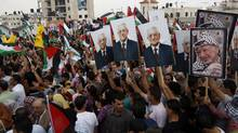 Thousands of cheering Palestinians welcome their president Mahmud Abbas (poster) outside his Ramallah headquarters on Sept. 25, 2011, as he returned from delivering a historic UN membership bid. (Ahmad Gharabli/AFP/Getty Images/Ahmad Gharabli/AFP/Getty Images)