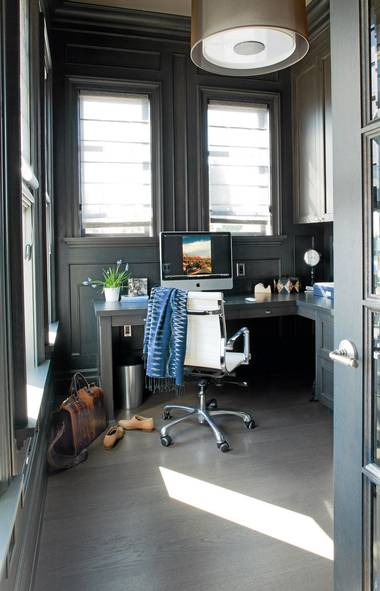 Office design by Kelly Deck. The depth of the dark finish on the wood pannelled walls draws you into the room's sensuous visual weight. (Barry Calhoun/Barry Calhoun)