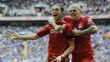 Liverpool's Andy Carroll, left, celebrates his goal against Everton with teammate Martin Skrtel during their English FA Cup semifinal soccer match at Wembley Stadium in London, Saturday, April 14, 2012. (Tom Hevezi/AP)