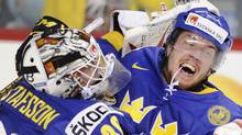 Sweden's Patrik Nemeth (R) celebrates with goalie Johan Gustafsson after scoring the winning goal in overtime to defeat Russia at the 2012 IIHF U20 World Junior Hockey Championship in Calgary, Alberta, December 31, 2011. REUTERS/Mike Sturk (Mike Sturk/Reuters)