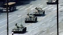 A man blocks a column of army tanks on Changan Avenue east of Tiananmen Square in Beijing in this June 5, 1989 file photo. This year marks the 20th anniversary of the bloody June 4, 1989 crackdown on the pro-democracy movement in the square. REUTERS/Arthur Tsang/Files (CHINA CONFLICT ANNIVERSARY IMAGES OF THE DAY) (STAFF/REUTERS)