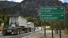 Roadside signs along the Sea to Sky Highway in B.C. are written in both English and the language of the Squamish and Lil'Wat First Nations bands. (ANDY CLARK/REUTERS)