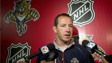 Florida Panthers hockey coach Kevin Dineen talks to the media, after an informal skate in Coral Springs, Fla., Friday, Sept. 14, 2012. (Associated Press)
