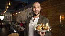 Anthony Rose of Fat Pasha shows off the latka platter. (Kevin Van Paassen for The Globe and Mail)