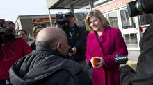NDP Leader Andrea Horwath discusses Ontario's budget with a group of people in Toronto. (Kevin Van Paassen/Kevin Van Paassen/The Globe and Mail)