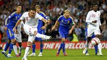 England's Frank Lampard scores a penalty against Ukraine during their 2014 World Cup qualifying soccer match at Wembley stadium in London September 11 , 2012. (DARREN STAPLES/REUTERS)