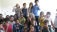 Children with their new harmonicas in Caucus, Georgia. (Margie Goldsmith)