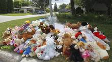 A memorial for two children who were drowned in their home lines a Winnipeg street on July 26, 2013. (JOHN WOODS/THE CANADIAN PRESS)