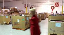 A woman walks through the Salvation Army's Railside Road food and toy distribution centre in Toronto on Wednesday, November 21, 2012. (Chris Young/THE CANADIAN PRESS)