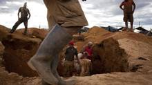 File photo of illegal miners digging in the earth in search of gold in a makeshift camp for illegal mining near Tumeremo in Venezuela's southern Bolivar state in this July 15, 2010 file photo. (Carlos Garcia Rawlins/REUTERS)