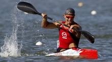 Adam Van Koeverden of Canada paddles to win the men's K1 1000m final during the ICF Canoe and Kayak Sprint World Championships in Szeged, 170km south of Budapest, August 19, 2011. (LASZLO BALOGH/Reuters)