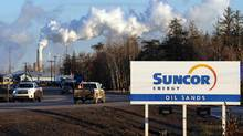 The $4.3-billion battle between Suncor Energy and Canadian Oil Sands was initially supposed to have been sewn up by early December (MARK RALSTON/AFP/Getty Images)