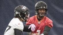 Redblacks QB Henry Burris hands off to RB Kienan Lafrance at practice for the 104th Grey Cup, in Toronto on Friday. (Frank Gunn/THE CANADIAN PRESS)