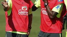 Brazil's national soccer team players Fred, left, and Jo chat during a training session in Teresopolis, near Rio de Janeiro, July 2, 2014. (STRINGER/BRAZIL/REUTERS)