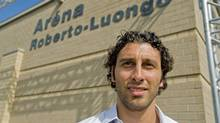 Vancouver Canucks' goaltender, Roberto Luongo, stands next to an arena newly named after him, at a ceremony in Montreal, Saturday, Aug. 22, 2009.The neighbourhood has produced two of the NHL's best goalies: the Devils' Martin Brodeur also cut his chops at the community rinkTHE CANADIAN PRESS/Graham Hughes