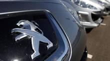 The Peugeot logo is seen on a car at a dealership Selestat, eastern France, Sept. 7, 2012. (VINCENT KESSLER/REUTERS)