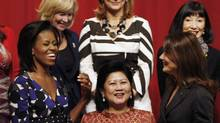 First ladies, Michelle Obama, left, Carla Bruni of France, right, chat as they pose during the G-20 Summit in Pittsburgh in 2009. (Gerald Herbert/Gerald Herbert/AP)
