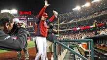 Washington manager Davey Johnson waves to the crowd acknowledges the crowd after the Nationals clinched a playoff berth last weekend. The franchise, which used to be in Montreal, hasn't been in the playoffs since 1981. (JONATHAN ERNST/REUTERS)
