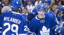 Toronto Maple Leafs' William Nylander, left, congratulates Mitch Marner after the team's 4-1 win over the Boston Bruins on Oct. 15, 2016. (Chris Young/The Canadian Press)