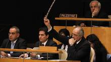 Syrian representative Bashar Ja'afari raises an objection during a meeting of the United Nations General Assembly to discuss the human rights situation in Syria, at UN headquarters in New York on Feb. 13, 2012. (Jason DeCrow/AP/Jason DeCrow/AP)