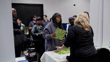 Job seekers, left, speak with a recruiter during a Giant Job Fair in Detroit, Michigan, U.S., on Wednesday, Dec. 30, 2015. The lack of workers adequately trained for a more technologically demanding workplace is slowing growth, not the other way around, Peter Morici argues. (Laura McDermott/Bloomberg)