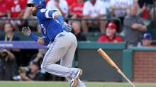 Blue Jays right fielder Jose Bautista (19) hits an RBI single in the third inning against the Texas Rangers during game one of the 2016 ALDS playoff baseball game at Globe Life Park in Arlington on Oct. 6, 2016. (Kevin Jairaj/USA Today Sports)