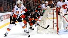 Jakob Silfverberg of the Anaheim Ducks defends as Michael Stone of the Calgary Flames passes the puck during the third period of Game Two of the Western Conference first-round series on April 15, 2017 in Anaheim, Calif. (Sean M. Haffey/Getty Images)