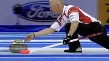 Glenn Howard delivers his stone during play against Scotland in the gold medal game at the World Men's Curling Championship 2012 in Basel April 8, 2012. (ARND WIEGMANN/REUTERS)