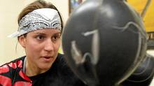 World Welterweight Champion, Mary Spencer hits a bag during a training session at the Windsor Amateur Boxing Club in Windsor, Ontario, May 6, 2010.__GEOFF ROBINS The Globe and Mail (GEOFF ROBINS/The Globe and Mail)
