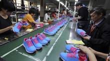 Chinese workers manufacture sports shoes at a shoe factory in Jinjiang in southeast China's Fujian province Friday Nov. 9, 2012. (AP)