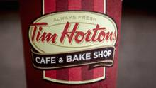 A Tim Hortons coffee cup is seen on the ground outside a shop near Times Square in New York August 26, 2014. (BRENDAN MCDERMID/REUTERS)
