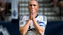 Vancouver Whitecaps' Kenny Miller reacts after missing a scoring chance against Chivas USA back on Sept. 1 (DARRYL DYCK/The Canadian Press)