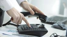 Business Telephone (stokkete/Getty Images/iStockphoto)