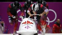Canada's pilot Justin Kripps (front R), Jesse Lumsden, Cody Sorensen and Ben Coakwell start a heat during the four-man bobsleigh event at the Sochi 2014 Winter Olympics, at the Sanki Sliding Center in Rosa Khutor February 22, 2014. (ARND WIEGMANN/REUTERS)