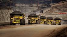 Caterpillar trucks working in the oil sands in Alberta. In response to proposed European Union rules, a new Alberta government-sponsored study says oil sands crude is not significantly higher in greenhouse gas footprint than other crudes used in Europe. (Jim Dugan/Caterpillar/Jim Dugan/Caterpillar)