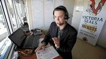 Victoria Seals announcer Mike Walker, 22, in the press box at Royal Athletic Park on July 25. (Deddeda Stemler for The Globe and Mail)