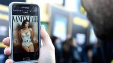 A photo editor views the July cover of Vanity Fair featuring Caitlyn Jenner on June 1, 2015 in Westwood, California. (Frazer Harrison/Getty Images)