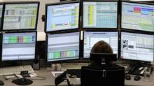 A trader is pictured at her desk in front of screens at the Frankfurt stock exchange. (AMANDA ANDERSEN/REUTERS)