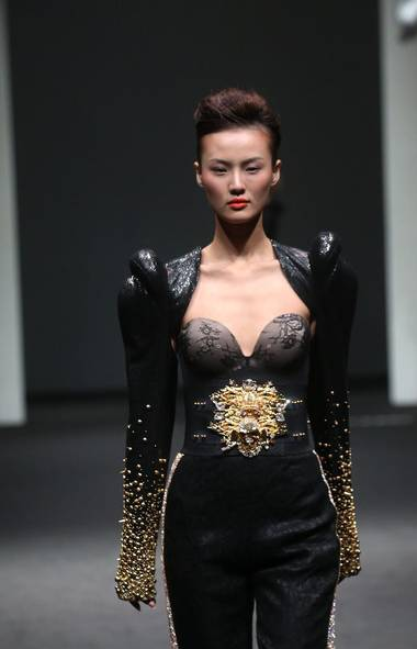 A model wears a creation by designer On Aura Tout Vu at the French Couture 2012 Singapore fashion show.