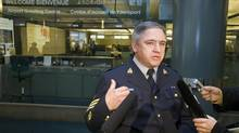 RCMP spokesman Sergeant Pierre Lemaitre talks to the media in front of an area at the Vancouver International Airport arrivals area where Robert Dziekanski was tasered by police in the early hours of Oct. 14, 2007. (Jeff Vinnick for The Globe and Mail)