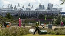 A gardener works at the Olympic Park in east London on August 14, 2012. London Mayor Boris Johnson announced July 25, 2013 that the city has plans to build an giant indoor snow centre next to the Olympic Park. (PAUL HACKETT/Reuters)