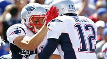 New England Patriots' Julian Edelman, left, celebrates with teammate Tom Brady, right, after catching a touchdown pass during the first half of an NFL game against the Buffalo Bills, Sunday, Sept. 8, 2013, in Orchard Park. (Bill Wippert/AP)