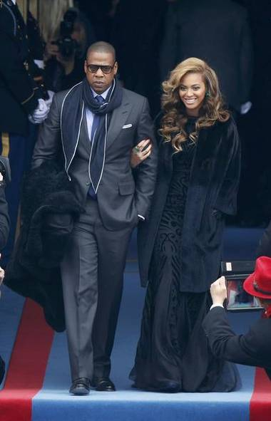The most powerful couple in the world arrive at the swearing-in ceremonies for U.S. President Barack Obama in Washington on Monday. (Reuters)