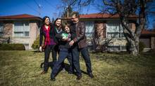 Nico Montoya, a 13-year-old boy with Down syndrome, plays soccer with his home with his father Felipe, right, his sister Tania, second left, and his mother Alejandra Garcia, left, at their home in Richmond Hill, Ont., on Saturday, March 19, 2016. (Mark Blinch/THE CANADIAN PRESS)
